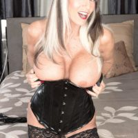 Stripper boot and spandex garbed experienced pornostar Sally D'Angelo wanking and sucking large wood