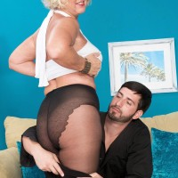 Tights and micro-skirt garbed granny Jeannie Lou sucking off gigantic sausage on knees